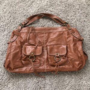 Barney's brown shoulder bag